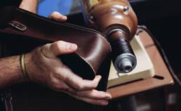 Adam making a leather bag